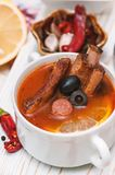 Soup with smoked meat, olives and lemon. Solyanka soup Stock Images