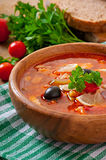 Soup solyanka Russian with meat, olives and gherkins Royalty Free Stock Photos