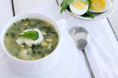 Soup with sorrel and nettles. Green borsch with nettles, sorrel and boiled eggs Royalty Free Stock Image