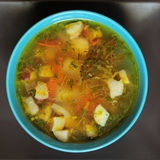 Soup. Tasty soup in blue bowl close up Stock Images