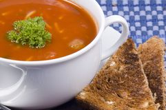 Soup and toast. A picture of a delicious bowl of soup with toast on the side stock photo