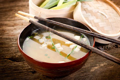 Soup with tofu and seaweed. On wood bowl  with chopsticks Stock Image