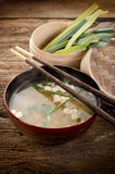 Soup with tofu and seaweed. On wood bowl  with chopsticks Royalty Free Stock Image