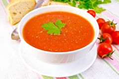 Soup tomato in bowl on linen napkin Royalty Free Stock Image