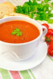 Soup tomato in bowl with tomatoes on linen napkin Royalty Free Stock Photos
