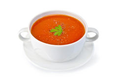 Soup tomato with parsley in white bowl on saucer Stock Photos