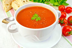 Soup tomato with peppers in bowl on linen napkin Royalty Free Stock Photo