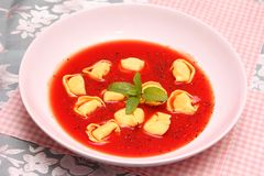Soup of tomatoes with tortellini Stock Photo
