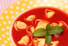 Soup of tomatoes with tortellini Stock Photos