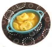 Soup with tortellini Stock Images
