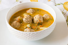 Soup with turkey meatballs, potatoes and vegetables. Stock Images