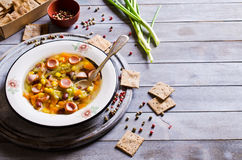 Soup with vegetables and sausages Stock Photography