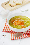 Soup with vegetables in a white bowl. On a wooden background Royalty Free Stock Photos
