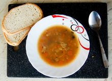 Soup on a white plate with bread Royalty Free Stock Image