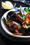 Soup of wild mussels with white wine, vegetables, sage and coriander Stock Photo