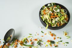 Soup or wok vegetables, ingredients, on white table royalty free stock photography
