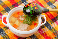 Soup and a wooden spoon Stock Images