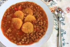 Soupe à lentille avec des plantains Photographie stock