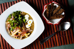 Soupe à lentille avec le lard et les pâtes Photo stock
