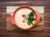 Soupe crème avec saucisses Images stock