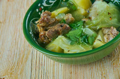 Soupe Djiboutienne. Fah - Fah  -  Soupe Soupe Djiboutienne. classic dish made typically of goat meat with vegetables and green chilies Stock Photos