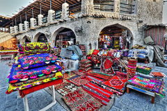 Souq markets in Doha. The local souq market in Doha, Qatar, is one of the most notable being the Souq Waqif, where one can haggle over traditional wares in a Stock Photography