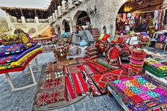 Souq markets in Doha. The local souq market in Doha, Qatar, is one of the most notable being the Souq Waqif, where one can haggle over traditional wares in a Royalty Free Stock Image