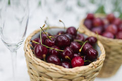 Sour cherries in basket Royalty Free Stock Photo