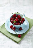 Sour Cherries in a Cup Stock Images