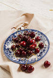 Sour  cherries on dish , close-up Royalty Free Stock Images