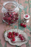 Sour Cherries with Sugar. On a Vintage Wooden Table Royalty Free Stock Photography