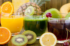 Sour cherry, apple and orange juice Royalty Free Stock Photos