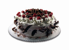Sour cherry cake. With chocolate and cream isolated Stock Photo