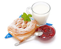 Sour cherry cake, jam and a cup of milk Stock Photos