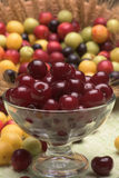 Sour cherry and cherry plums. In a glass bowl Stock Photography