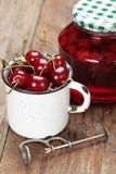 Sour cherry fruits and jam Stock Photo
