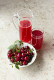Sour Cherry. Homemade cherry juice with fresh sour cherries Royalty Free Stock Images