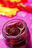 Sour cherry jam in jar. Sour cherry jam in opened screw-top jar Royalty Free Stock Image