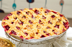 Sour cherry pie. Traditional sour cherry pie with almond flakes stock photography