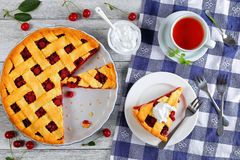 Sour cherry pie with whipped cream Stock Images