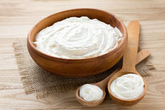 Sour cream. Homemade sour cream in a wooden bowl Royalty Free Stock Photography