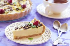 Sour cream cheesecake with chocolate, raspberries and mint Royalty Free Stock Photo