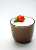 Strawberry in sour cream on the cup Royalty Free Stock Image
