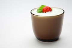 Strawberry in sour cream on the cup Stock Photography