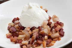 Sour cream on the fried sliced bacon Royalty Free Stock Photography