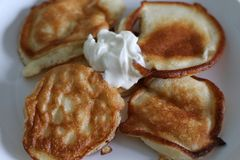 Sour cream on homemade pancakes royalty free stock image