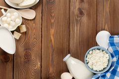 Sour cream, milk, cheese, eggs, yogurt and butter. Dairy products on wooden table. Sour cream, milk, cheese, eggs, yogurt and butter. Top view with copy space stock photo