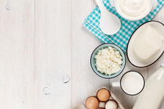 Sour cream, milk, cheese, eggs and yogurt. Dairy products on wooden table. Sour cream, milk, cheese, eggs and yogurt. Top view with copy space royalty free stock photos