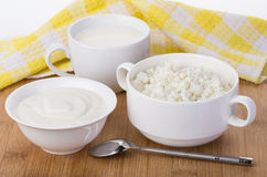 Sour cream, milk and cottage cheese and napkin Royalty Free Stock Photo