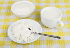 Sour cream, milk in cup and cottage cheese  on table Stock Photo